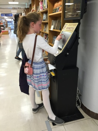 Checking out the selection at Kinokinuya Books